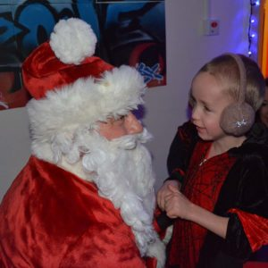 Supported child with Father Christmas