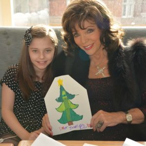 Joan Collins with Ruby at Selfridges