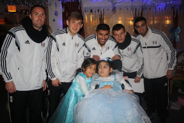 Fulham FC players with a supported child and her cousin