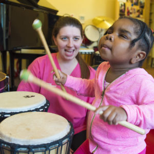 Supported child in Music Therapy