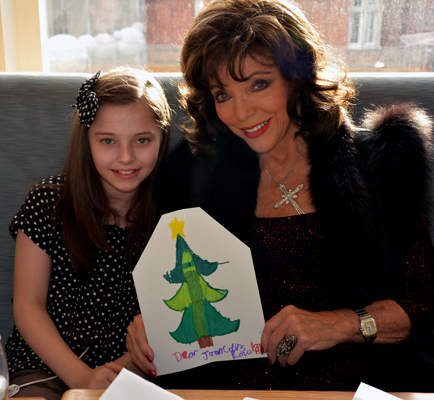 Joan Collins Selfridges Christmas breakfast - receiving a card from Ruby