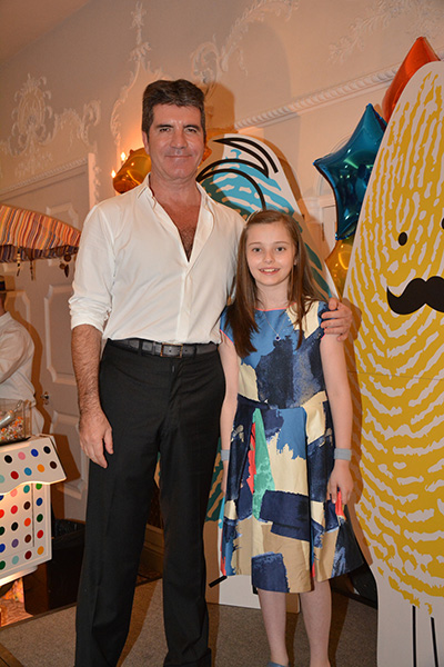 Simon with supported child, Ruby
