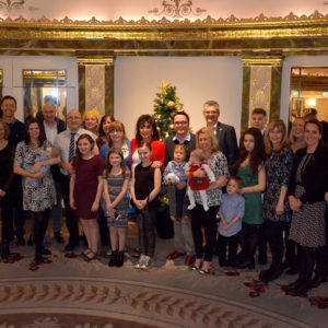 Joan Collins with families for Afternoon Tea