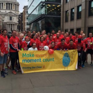 Corporate team running for Shooting Star Children's Hospices