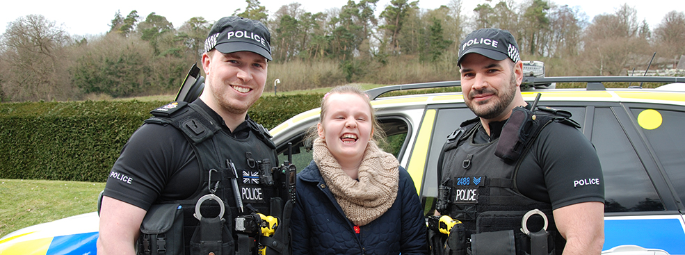 Lily meets officers from the Surrey Police banner
