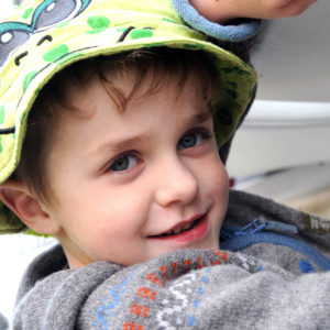 Supported child wearing hat