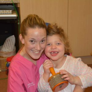 Supported child Evie with Hannah from care team