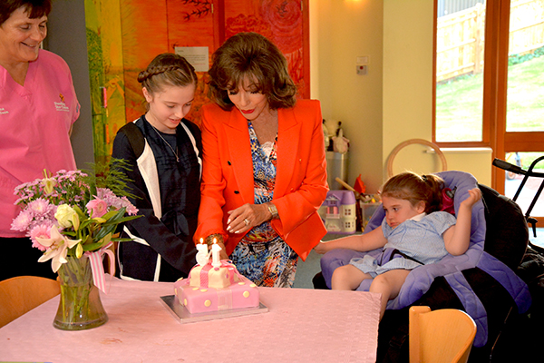 dame-joan-cuts-christophers-15th-birthday-cake