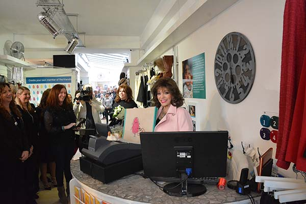 Dame Joan Collins helps at Fulham Shop