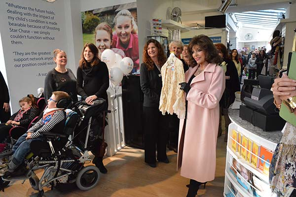 Dame Joan Collins showcases items at Fulham shop