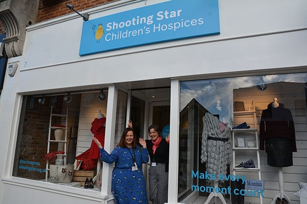 Shop manager Helen and volunteer Michaela welcome people to Cobham shop
